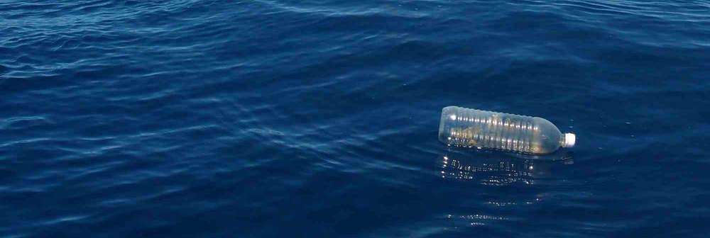 Plastic water bottle in the ocean