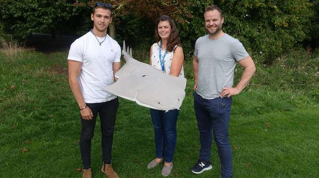 Jake Davies, Joanna Barker and Jon Fidler holding angelshark model