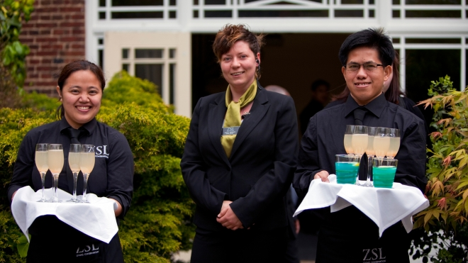 Staff offering out drinks at a corporate event